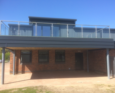 Balcony-using-a-Stainless-steel-balustrade-with-glass-infill